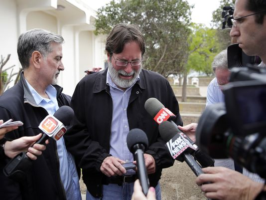 Richard Martinez (center) at a press conference. Photo courtesy of USA Today.